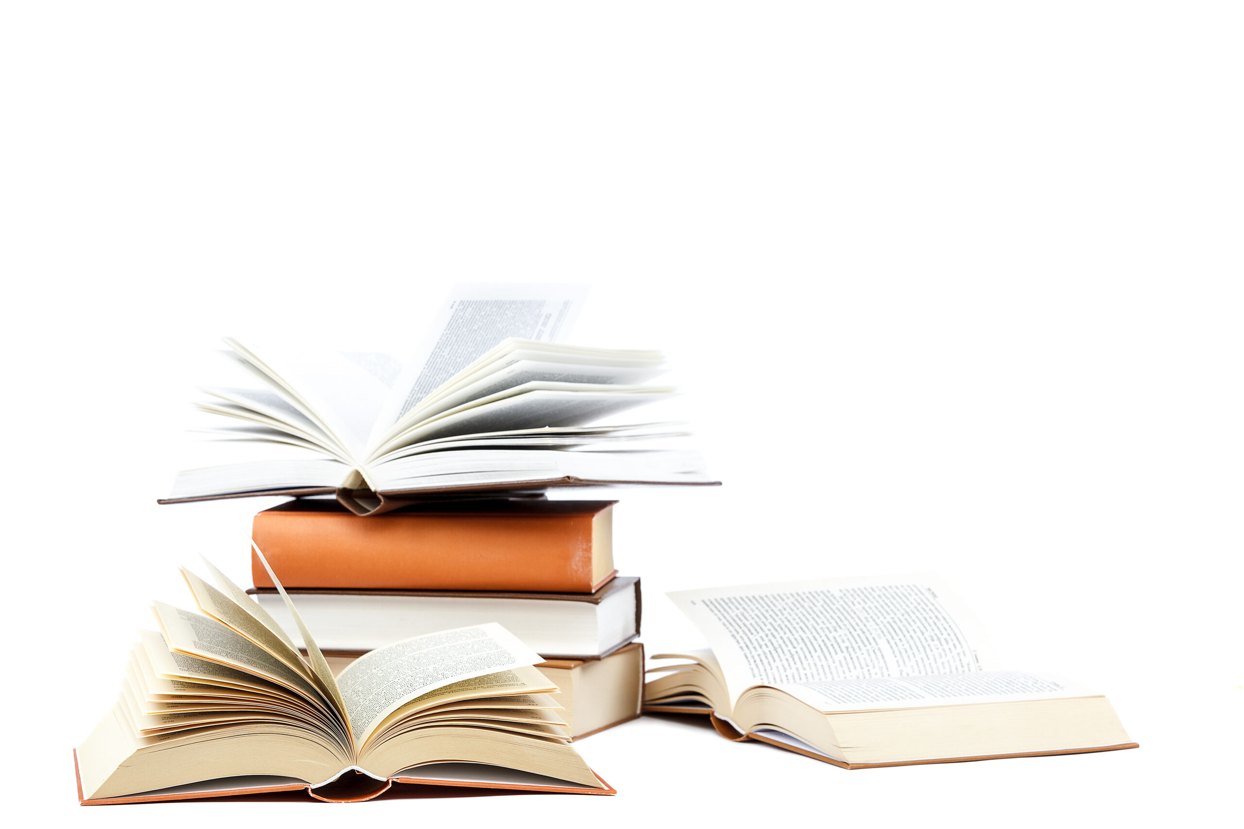 Books In A Stack On White Background.